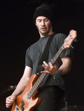 keanu-reeves-on-stage-performing-at-the-glastonbury-festival-with-his-group-dogstar-june-1999
